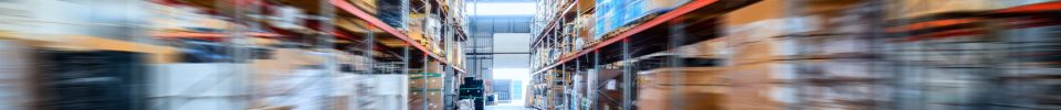 Warehouse industrial and logistics companies. Long shelves with a variety of boxes and containers. Motion blur effect.